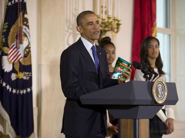"Obama brandishing Wii U title ""Rise Of Lyric"" at the ceremony as his unimpressed daughters look on."